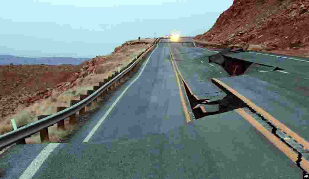"The buckling of U.S. 89 is seen about 25 miles south of Page, Arizona, Feb. 20, 2013. Arizona Department of Transportation (ADOT) says what caused a 150-foot section of pavement to buckle might be what ADOT calls a ""geologic event."" (Photo provided by ADOT)"