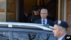 FILE - Zivko Budimir, a president of the Bosniak-Croat Federation, is escorted by police during his arrest, in the Bosnian capital of Sarajevo, April 26, 2013.