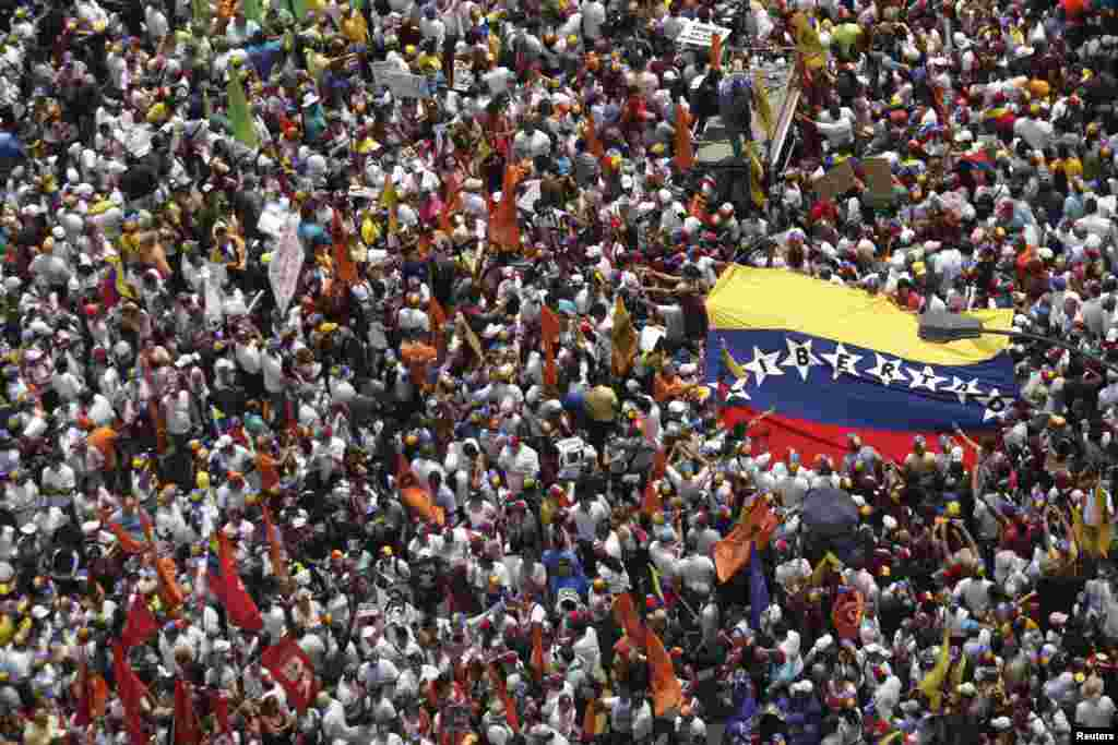 Opposition supporters march to protest against Nicolas Maduro's government in Caracas, Venezuela.