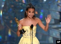 "Alicia Vikander accepts the award for best actress in a supporting role for ""The Danish Girl"" at the Oscars on Feb. 28, 2016, at the Dolby Theatre in Los Angeles."