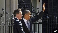 US President Barack Obama, right, with British Prime Minister David Cameron in front of 10 Downing Street in London, Wednesday, May 25, 2011