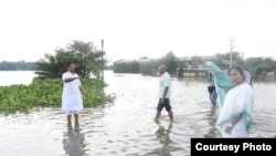 West Bengal Chief Minister Mamata Banerjee visits flood areas.