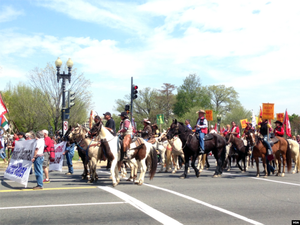 """The Cowboy and Indian Alliance, a coalition of Native American tribes, ranchers, and farmers, stages a """"Reject and Protect"""" protest against the Keystone XL oil pipeline project outside Capitol Hill, Washington D.C., April 22, 2014. (Diaa Bekheet/VOA)"""