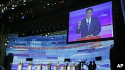 US Republican presidential candidate Mitt Romney is seen on the screen during the presidential candidate debate in Ames, Iowa, August 12, 2011 (file photo)