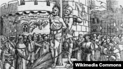 "William Tyndale is burnt at the stake in Belgium; he cries, ""Lord ope the king of England's eies."" From an Elizabethan edition of Foxe's Martyrs. (Wikimedia)"