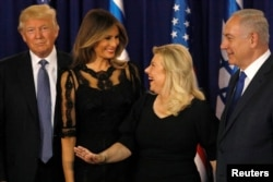 Melania Trump (2nd L) and Sara Netanyahu (2nd R) walk onstage with their respective husbands, U.S. President Donald Trump (L) and Israel's Prime Minister Benjamin Netanyahu (R), before a dinner at Netanyahu's residence in Jerusalem, May 22, 2017.