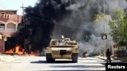 A military vehicle of the Iraqi army with Shi'ite Popular Mobilization Forces (PMF) is seen during a fight with Islamic State militants in Tal Afar, Iraq, Aug. 26, 2017.