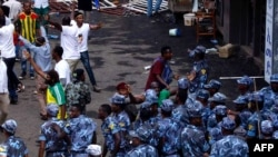Ethiopian security forces intervene on Meskel Square in Addis Ababa, June 23, 2018, where a blast killed several people during a rally called by the Prime Minister Abiy Ahmed.