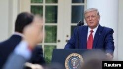 美国总统特朗普出席白宫记者会(路透社2020年7月14日)