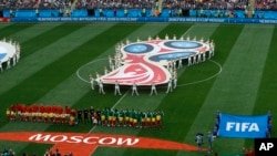 The teams of Russia and Saudi Arabia line up prior to their group A march which opens the 2018 soccer World Cup at the Luzhniki stadium in Moscow, Russia, Thursday, June 14, 2018. (AP Photo/Victor Caivano)