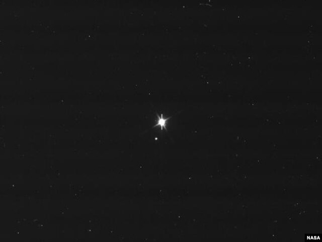 This image of Earth and the moon was taken by NASA's Cassini spacecraft on July 19, 2013. Image Credit: NASA/JPL-Caltech/Space Science Institute