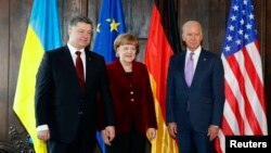 From left, Ukraine's President Petro Poroshenko, German Chancellor Angela Merkel and U.S. Vice President Joe Biden pose.