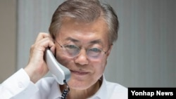 President Moon Jae-In talks over the phone with President Donald Trump.