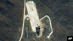 Satellite image provided by DigitalGlobe shows the Tongch'ang-ni Launch Facility on North Korea's northwest coast, April 6, 2012.