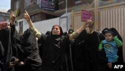 Activists of Kashmir's right wing all-woman organisation Dukhtaran-E-Milat (Daughters of the Faith) shout anti-US slogans during a protest in Srinagar, Sept. 21, 2012