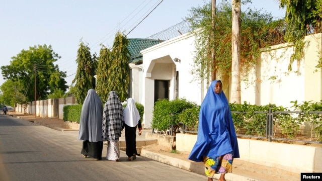 Women walk in a street in a residential area in Maiduguri, Borno State May 19, 2013, an area where President Goodluck Jonathan has declared a state of emergency.