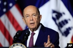 FILE - Department of Commerce Secretary Wilbur Ross speaks to department workers in Washington, July 16, 2018.