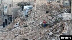 حلب کے مضافاتی علاقے قادی میں بمباری کے بعد کا منظر۔ 24 نومبر 2016