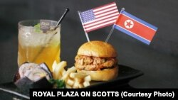 Royal Plaza on Scotts' grilled Trump-Kim Burger is made up of a minced chicken, seaweed and kimchi patty, served with Korean rice rolls and fries.
