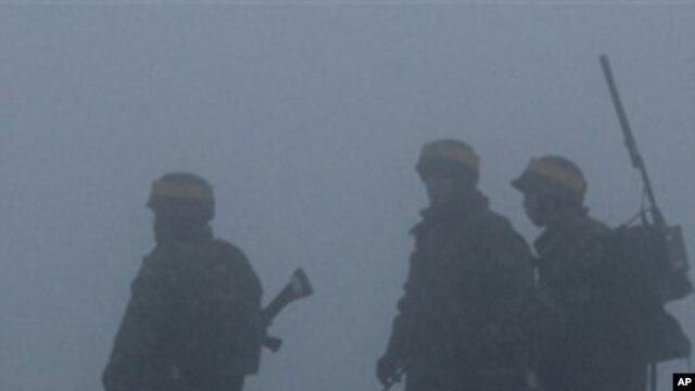 South Korean Marines patrol on Yeonpyeong island, South Korea, ahead of expected live-fire artillery exercises, Dec. 20, 2010.