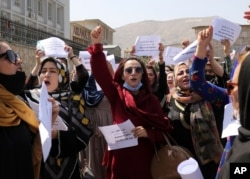 Women gather to demand their rights under the Taliban rule during a protest in Kabul, Afghanistan, Sept. 3, 2021.