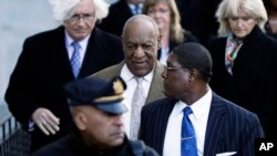 Bill Cosby, center, departs a pretrial hearing in his sexual assault case at the Montgomery County Courthouse, March 5, 2018, in Norristown, Pennsylvania.