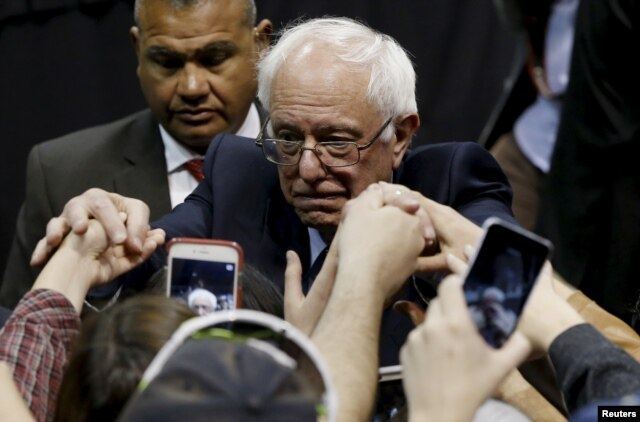 Democratic U.S. presidential candidate Bernie Sanders shakes hands with supporters during a campaign rally at Missouri State University in Springfield, Mo., March 12, 2016.