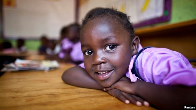 FILE - A four-year-old deaf student sits inside her classroom in the specialized deaf unit program at the Little Rock Inclusive Early Childhood Development Center in Kenya's capital Nairobi.