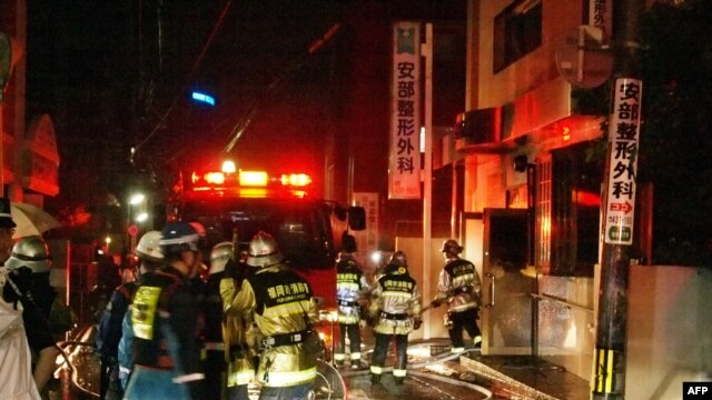Firefighters attempt to contain a fire at a hospital in Fukuoka, western Japan, Oct. 11, 2013.