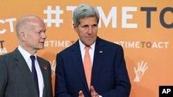 جان کری و ویلیام هیگ، وزیران خارجه آمریکا و بریتانیا در نشست سران جهان برای پایان دادن به خشونت های جنسی در جنگ ها