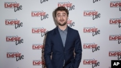 FILE - Daniel Radcliffe poses for photographers at the Empire Live event, in London, Sept. 23, 2016.