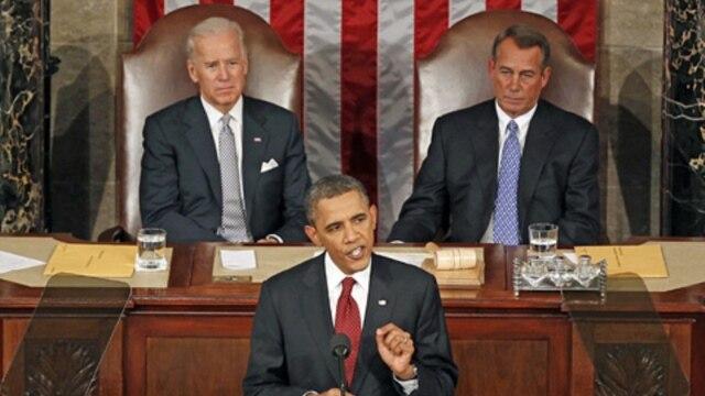 President Barack Obama delivering the 2012 State of the Union address on Capitol Hill.  Vice President Joe Biden, left, and House Speaker John Boehner sit behind him.