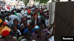 "Haitians stand outside the Ministry of Interior and Police while waiting to register in the so-called ""regularization"" program, in Santo Domingo, June 17, 2015."