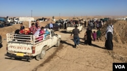 Many arriving families found relatives either in the camp or waiting in the parking lot, after more than two years of separation on Nov. 3, 2016, at the Khazir camp in Kurdish Iraq. (H. Murdock/VOA)