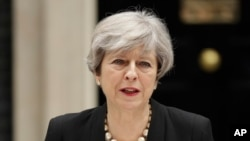British Prime Minister Theresa May addresses the media outside 10 Downing Street, London, May 23, 2017, the day after an apparent suicide bomber attacked an Ariana Grande concert as it ended Monday night.