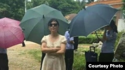 郭飛雄姐姐楊茂平在監獄外(維權網圖片)