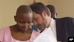 Victoire Ingabire, left, outspoken critic of Rwandan President Paul Kagame, on trial, Kigali, Sept. 2011 (file photo).