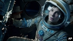 "FILE - This film image released by Warner Bros. Pictures shows Sandra Bullock in a scene from the movie ""Gravity."""