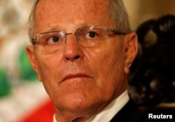 FILE - Peru's President Pedro Pablo Kuczynski attends a binational cabinet meeting at the Government Palace in Lima, Peru, July 7, 2017.