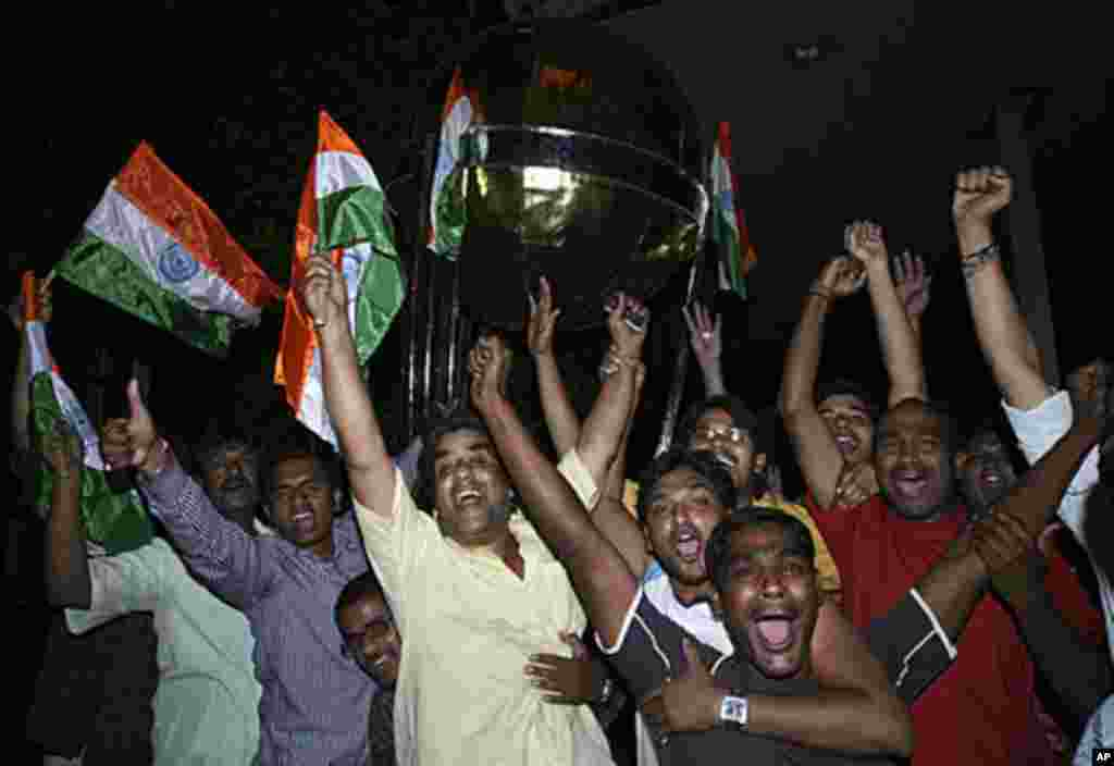 Cricket fans celebrate after India won the ICC Cricket World Cup semi-final match against Pakistan, in the southern Indian city of Hyderabad, March 30, 2011.