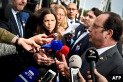 French President Francois Hollande speaks to reporters at the Southern EU countries summit held at Belem cultural center in Lisbon, Portugal, Jan. 28, 2017.