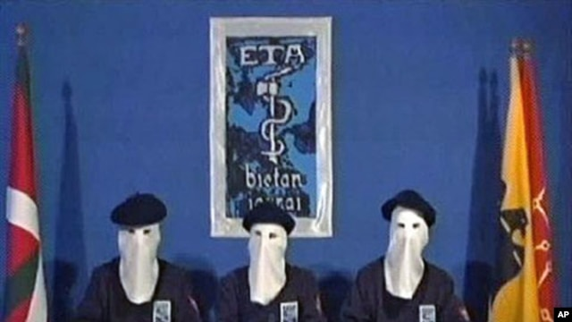 In this image taken from video, masked members of the militant Basque separatist group ETA declare a permanent cease-fire in a video distributed to Spanish media, Jan 10, 2011