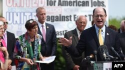 U.S. Rep. Brad Sherman of California and fellow Democrats in Congress hold a news conference to voice opposition to the Trans-Pacific Partnership trade deal and fast-track trade authority for the president in Washington, June 10, 2015.
