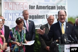 FILE - U.S. Rep. Brad Sherman of California and fellow Democratic members of Congress hold a news conference to voice their opposition to the Trans-Pacific Partnership trade deal and fast-track trade authority for the president at the U.S. Capitol in Washington, June 10, 2015.