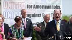 U.S. Rep. Brad Sherman of California and fellow Democratic members of Congress hold a news conference to voice their opposition to the Trans-Pacific Partnership trade deal and fast-track trade authority for the president at the U.S. Capitol in Washington,