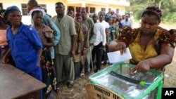 A woman casts her vote in a ballot box n empty ballot box at Agulu in Anambra State on February 6, 2010. Glitches marred voting for a new governor Saturday in Nigeria's turbulent Anambra state, seen as a litmus test of whether Africa's largest democracy c