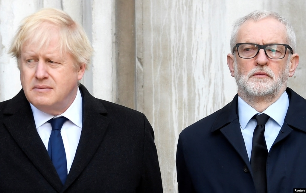 Britain's Prime Minister Boris Johnson and opposition Labour Party leader Jeremy Corbyn attend a memorial event for victims of a deadly attack on the London Bridge.