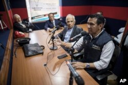 Wilson Florez, candidate of Democratic Center political party for the government of Cundinamarca, speaks at a radio station during an interview in Bogota, Colombia, Oct. 23, 2019.