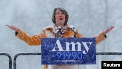 U.S. Senator Amy Klobuchar gestures skyward as she announces her candidacy for the 2020 Democratic presidential nomination in Minneapolis, Minnesota, U.S., February 10, 2019.