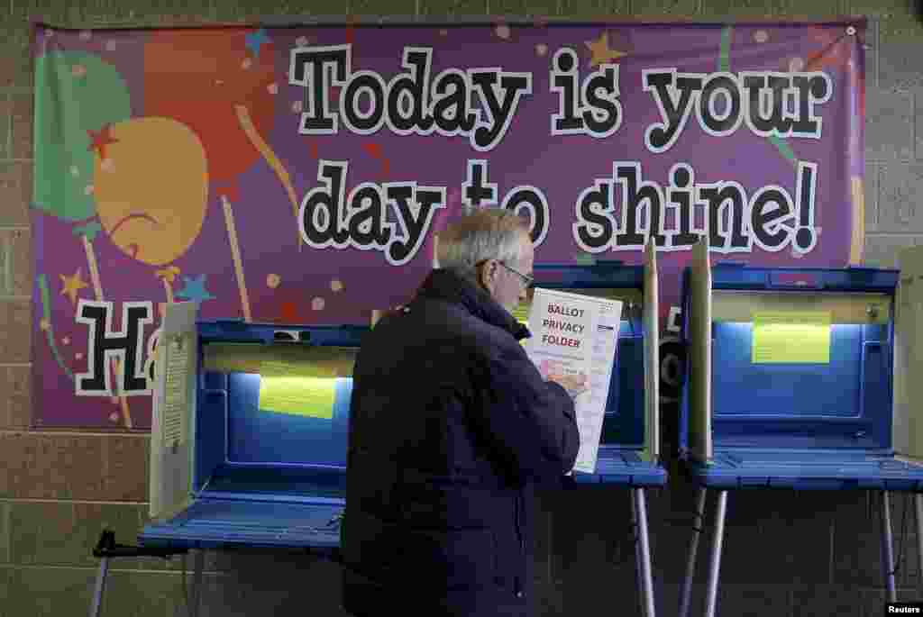 A voter casts his ballot in the Wisconsin presidential primary at a voting station in Milwaukee, Wisconsin, USA.